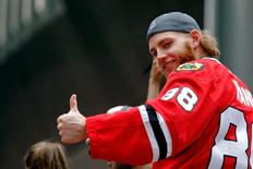 Jun 18, 2015; Chicago, IL, USA; Chicago Blackhawks right wing Patrick Kane (88) gives a thumbs up to the crowd during the 2015 Stanley Cup championship parade and rally at Soldier Field. Jon Durr-USA TODAY Sports
