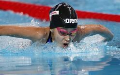 Ten year-old Alzain Tareq of Bahrain swims in a women's 50 m butterfly heat at the Aquatics World Championships in Kazan, Russia, August 7, 2015.   REUTERS/Stefan Wermuth