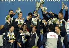 Team Serbia poses with their trophy and gold medals after taking first place in the men's water polo during the Aquatics World Championships in Kazan, Russia, August 8, 2015.    REUTERS/Michael Dalder