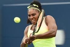 Aug 11, 2015; Toronto, Ontario, Canada; Serena Williams of the United States hits a shot against Flavia Pennetta of Italy (not pictured) during the Rogers Cup tennis tournament at Aviva Centre.   Dan Hamilton-USA TODAY Sports