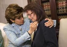 Attorney Gloria Allred comforts Linda Ridgeway Whitedeer, a former actress, as she speaks about her alleged assault by Bill Cosby during a news conference with new accusers against comedian Bill Cosby at attorney Gloria Allred's office in Los Angeles, California August 12, 2015.  REUTERS/Patrick T. Fallon