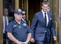 New England Patriots quarterback Tom Brady exits the Manhattan Federal Courthouse in New York August 12, 2015. REUTERS/Brendan McDermid