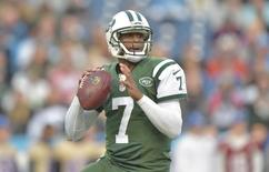 Dec 14, 2014; Nashville, TN, USA; New York Jets quarterback Geno Smith (7) drops back to throw against the Tennessee Titans during the first half at LP Field.   Don McPeak-USA TODAY Sports