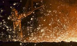 A steel-worker is pictured at a furnace at the plant of German steel company Salzgitter AG in Salzgitter, Lower Saxony on March 17, 2015.  REUTERS/Fabian Bimmer