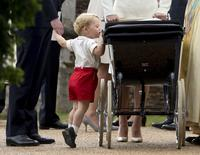 Britain's Prince George looks into the pram of his sister, Princess Charlotte, after her christening at the Church of St Mary Magdalene in Sandringham, Britain in this file photograph dated July 5, 2015. REUTERS/Matt Dunham/pool/Files