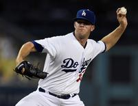 Aug 14, 2015; Los Angeles, CA, USA; Los Angeles Dodgers starting pitcher Alex Wood (57) pitches during the third inning against the Cincinnati Reds at Dodger Stadium. Mandatory Credit: Kelvin Kuo-USA TODAY Sports