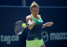 Aug 15, 2015; Toronto, Ontario, Canada; Simona Halep of Romania returns a ball to Sara Errani of Italy (not pictured) during their semi final match at the Rogers Cup tennis tournament at the Aviva Centre. Halep won 6-4 6-4.  Nick Turchiaro-USA TODAY Sports