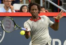 Aug 10, 2015; Montreal, Quebec, Canada;  Gael Monfils of France hits the ball against Fabio Fognini of Italy (not pictured) during the Rogers Cup tennis tournament at Uniprix Stadium. Mandatory Credit: Eric Bolte-USA TODAY Sports