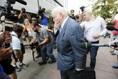 Suspended Senator Mike Duffy arrives at the courthouse in Ottawa, Canada August 18, 2015. REUTERS/Chris Wattie