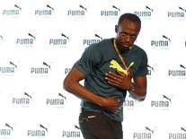 Jamaican sprinter Usain Bolt greets journalists after his news conference ahead of the IAAF (International Association of Athletics Federations) World Championships, in Beijing, China, August 20, 2015. REUTERS/Kim Kyung-Hoon