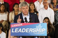 Canada's Prime Minister Stephen Harper speaks during a campaign stop at the WaterStone Estate and Farms in King Township, Ontario, August 20, 2015.  Harper announced policies that would provide tax relief for adoptive families if he is re-elected in the federal election on October 19. REUTERS/Mark Blinch
