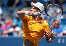 Novak Djokovic (SRB) returns a shot against David Goffin (not pictured) on day six during the Western and Southern Open tennis tournament at Linder Family Tennis Center.  Aaron Doster-USA TODAY Sports