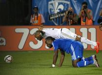 Aug 22, 2015; Montreal, Quebec, CAN; Philadelphia Union defender Fabinho (33) jumps over Montreal Impact forward Didier Drogba (11) during the second half at Stade Saputo. Jean-Yves Ahern-USA TODAY Sports