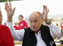 """FIFA President Sepp Blatter gestures before the first game of the so-called """"Sepp Blatter tournament"""" in Blatter's home-town Ulrichen, Switzerland, August 22, 2015.  REUTERS/Denis Balibouse"""