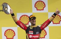Lotus Formula One driver Romain Grosjean of France celebrates his third place in the Belgian F1 Grand Prix in Spa-Francorchamps August 23, 2015.  REUTERS/Yves Herman