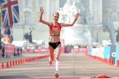 Liliya Shobukhova of Russia crosses the finish line to come in second during the women's section of the London marathon April 17, 2011. REUTERS/Paul Hackett