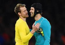 """Football - Arsenal v Liverpool - Barclays Premier League - Emirates Stadium - 24/8/15 Arsenal's Petr Cech with Liverpool's Simon Mignolet at full time Action Images via Reuters / Tony O'Brien Livepic EDITORIAL USE ONLY. No use with unauthorized audio, video, data, fixture lists, club/league logos or """"live"""" services. Online in-match use limited to 45 images, no video emulation. No use in betting, games or single club/league/player publications.  Please contact your account representative for further details."""