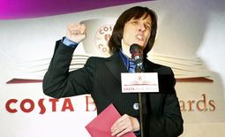 """Author A.L. Kennedy reacts after winning the Costa Book Award with her book """"Day"""" at the Intercontinental Hotel in central London in this file photograph dated January 22, 2008. REUTERS/Alessia Pierdomenico/files"""
