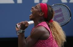 Serena Williams of the U.S. celebrates winning match point against Ekaterina Makarova of Russia during their semi-final match at the 2014 U.S. Open tennis tournament in New York, September 5, 2014.        REUTERS/Mike Segar