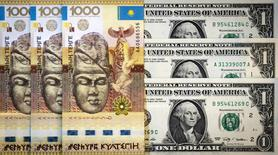 A picture illustration shows Kazakhstan's tenge and U.S. dollars banknotes in Almaty, Kazakhstan, August 21, 2015.  REUTERS/Shamil Zhumatov