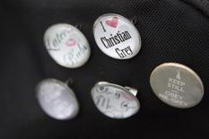 """""""Fifty Shades of Grey"""" badges are seen at the film's UK premiere in London, February 12, 2015. REUTERS/Neil Hall"""