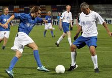 Austria's Foreign Minister Sebastian Kurz (L) and Kosovo's Foreign Minister Hashim Thaci fight for the ball during a politicians' soccer match ahead of the Western Balkans Summit in Vienna, Austria, August 26, 2015. REUTERS/Heinz-Peter Bader