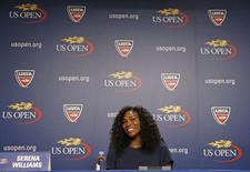 Serena Williams of the U.S. speaks during a news conference at the USTA Billie Jean King National Tennis Center ahead of the 2015 U.S. Open tennis tournament in New York, August 27, 2015. Play begins at the U.S. Open on August 31.  REUTERS/Mike Segar