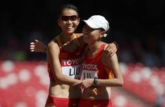 Liu Hong of China (L) celebrates with Lu Xiuzhi of China after winning the women's 20 km race walk final during the 15th IAAF World Championships at the National Stadium in Beijing, China August 28, 2015.   REUTERS/Lucy Nicholson