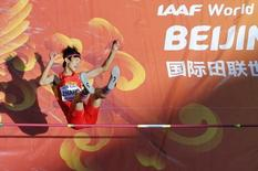 Guowei Zhang of China competes in the men's high jump qualification during the 15th IAAF World Championships at the National Stadium in Beijing, China August 28, 2015.  REUTERS/Fabrizio Bensch