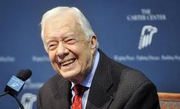 Former U.S. President Jimmy Carter takes questions from the media during a news conference about his recent cancer diagnosis and treatment plans, at the Carter Center in Atlanta, Georgia August 20, 2015. REUTERS/John Amis