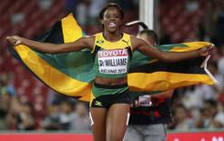 Danielle Williams of Jamaica reacts after winning the women's 100m hurdles during the 15th IAAF World Championships at the National Stadium in Beijing, China August 28, 2015. REUTERS/Lucy Nicholson