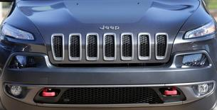 The front grill of a 2014 Chrysler Jeep Cherokee Trailhawk is seen on display outside Chrysler World Headquarters during the FCA Investors Day in Auburn Hills, Michigan May 6, 2014.   REUTERS/Rebecca Cook