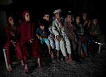 Afghan refugee children, returning from Pakistan, watch a short video clip about mines at a mines and explosives awareness program at a United Nations High Commissioner for Refugees (UNHCR) registration centre in Kabul, Afghanistan September 2, 2015. REUTERS/Ahmad Masood