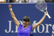 Petra Cetkovska of Czech Republic celebrates her win over Caroline Wozniacki of Denmark during their second round match at the U.S. Open Championships tennis tournament in New York, September 4, 2015. REUTERS/Shannon Stapleton