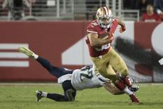 September 3, 2015; Santa Clara, CA, USA; San Francisco 49ers running back Jarryd Hayne (38) runs with the football against San Diego Chargers defensive back Johnny Lowdermilk (42) during the third quarter in a preseason game at Levi's Stadium. The 49ers defeated the Chargers 14-12.  Kyle Terada-USA TODAY Sports
