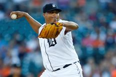 Detroit Tigers starting pitcher Alfredo Simon (31) pitches in the first inning against the Cleveland Indians at Comerica Park. Mandatory Credit: Rick Osentoski-USA TODAY Sports
