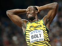 Usain Bolt comemora vitória no 4x100m no Mundial em Pequim.  29/8/2015.    REUTERS/Lucy Nicholson