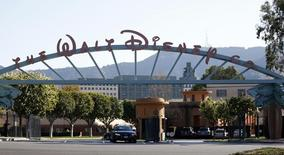 The entrance gate to The Walt Disney Co is pictured in Burbank, California in this February 5, 2014 file photo. REUTERS/Mario Anzuoni