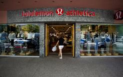 A woman walks into a store of yogawear retailer Lululemon Athletica in downtown Vancouver, in a June 11, 2014 file photo.  REUTERS/Ben Nelms/Files