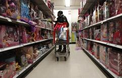 A woman shops for toys in a Kmart store in New York City, December 6, 2010.  REUTERS/Mike Segar
