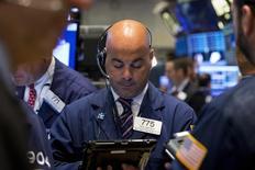 Traders work on the floor of the New York Stock Exchange September 11, 2015. REUTERS/Brendan McDermid