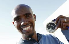 Athletics - Great North Run - Newcastle, Gateshead & South Shields - 13/9/15 Great Britain's Mo Farah celebrates with his Medal after winning the Men's Great North Run Action Images via Reuters / Craig Brough Livepic