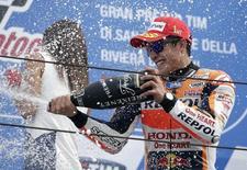 Honda MotoGP rider Marc Marquez of Spain celebrates on podium after winning the San Marino Grand Prix in Misano Adriatico circuit in central Italy September 13, 2015.   REUTERS/Max Rossi