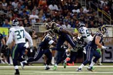 Sep 13, 2015; St. Louis, MO, USA; St. Louis Rams tight end Jared Cook (89) leaps into the air as Seattle Seahawks free safety Earl Thomas (29) defends during the first half at the Edward Jones Dome. Mandatory Credit: Jeff Curry-USA TODAY Sports
