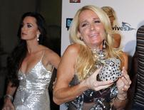 """Sisters and cast members of Bravo's new reality series """"The Real Housewives of Beverly Hills""""  Kyle Richards (L) and Kim Richards pose at the premiere party in Los Angeles October 11, 2010. REUTERS/Fred Prouser"""