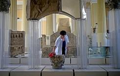 National Museum employee Djula Keric cleans archaeological excavations in National Museum in Sarajevo, September 9, 2015. REUTERS/Dado Ruvic