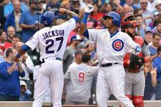 Chicago Cubs shortstop Starlin Castro (13) celebrates with right fielder Austin Jackson (27) after hitting a three-run home run off of St. Louis Cardinals relief pitcher Steve Cishek (not pictured) in the sixth inning at Wrigley Field. Jasen Vinlove-USA TODAY Sports