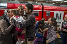 Ihab, 30 (C), a Syrian migrant from Deir al-Zor, cries as he and his familly are welcomed by his relatives upon their arrival at the railway station in Lubeck, Germany September 18, 2015. Picture taken September 18, 2015. REUTERS/Zohra Bensemra