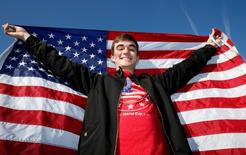 USA fan poses outside the stadium before the match. Action Images via Reuters / Peter Cziborra Livepic