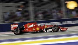 Ferrari Formula One driver Sebastian Vettel of Germany drives during the Singapore F1 Grand Prix at the Marina Bay street circuit September 20, 2015. REUTERS/Tim Chong